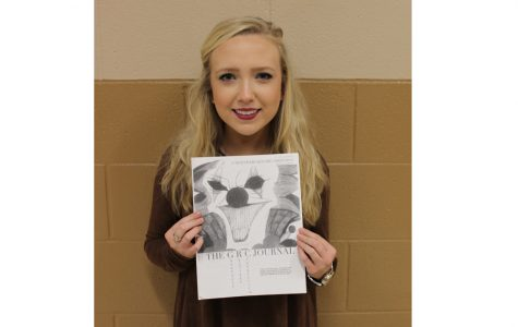 Co-founder Katie Wheeler holds the Literary Journal's first issue.