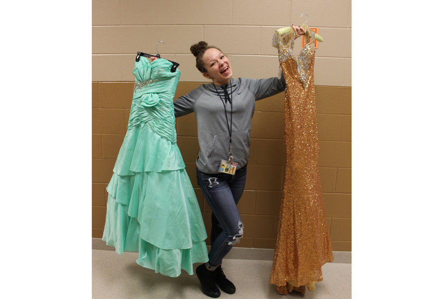 With more than 100 dresses to choose from, Aaliyah poses with a couple of her favorites.