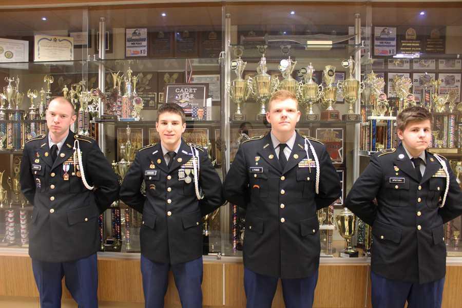Seniors Cody Gibson, Austin Howard, Austin Lykins, and Chris Mcintosh in uniform.