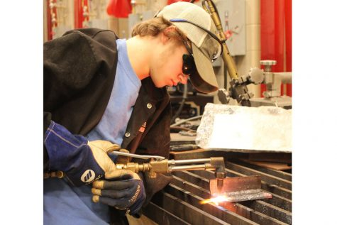 Chase Gabbard applies his skills in Welding class.