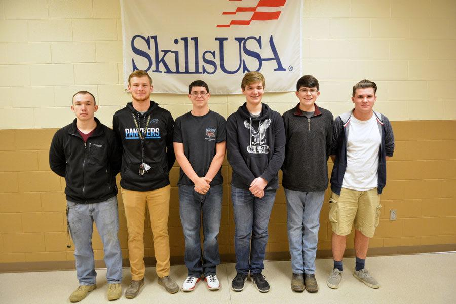 State qualifiers in Skills USA pose in front of banner. Not pictured: Austin Cartwright.