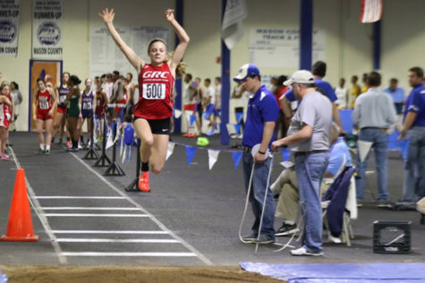 Makenzie Cooper performs her long jump.