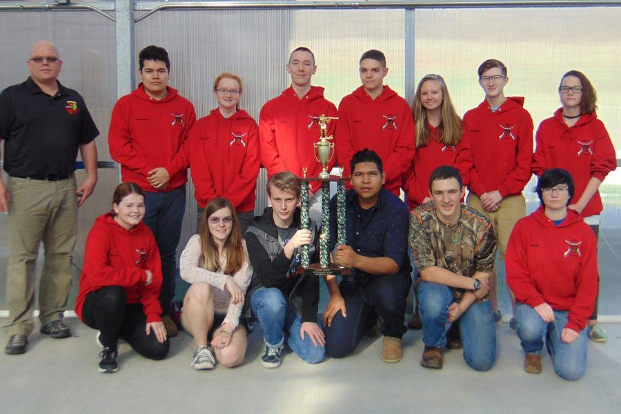 The+Air+Rifle+Team+poses+with+their+trophy.