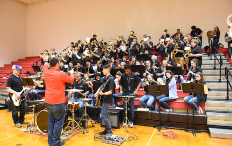 Mr. Payne directs the pep band during a basketball game.