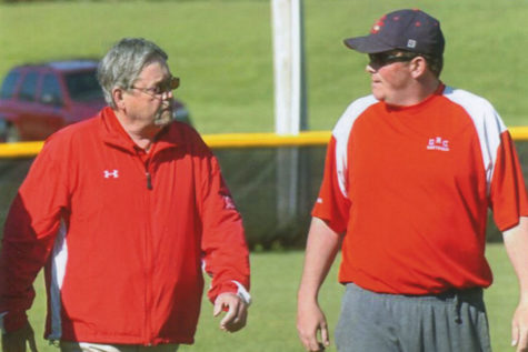The late Jerry Puckett discusses strategy before game with son and GRC head coach Matt Puckett.