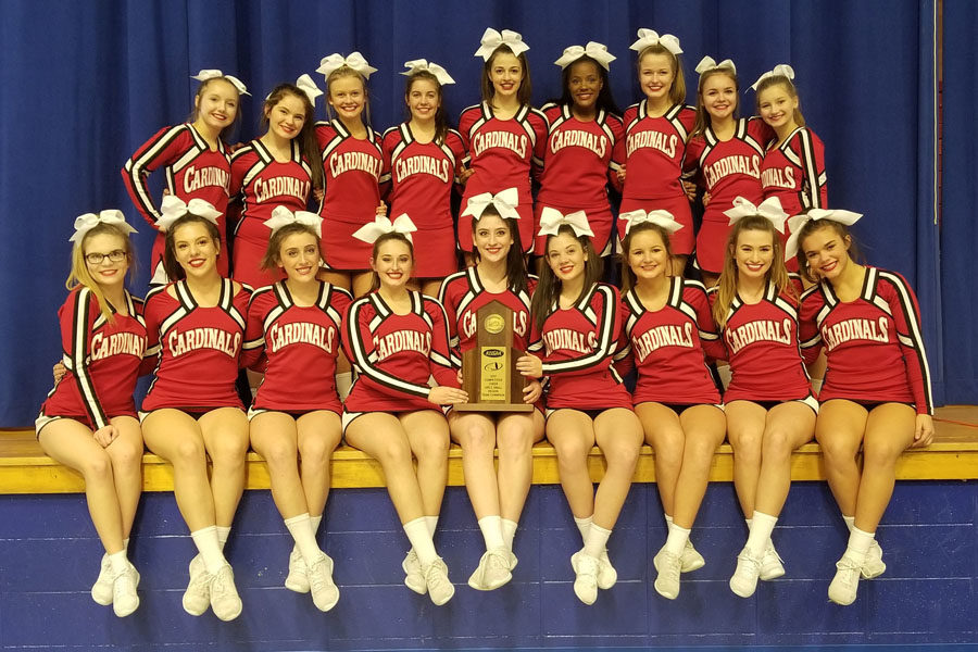 Cheerleaders+pose+with+the+Region+Championship+trophy.