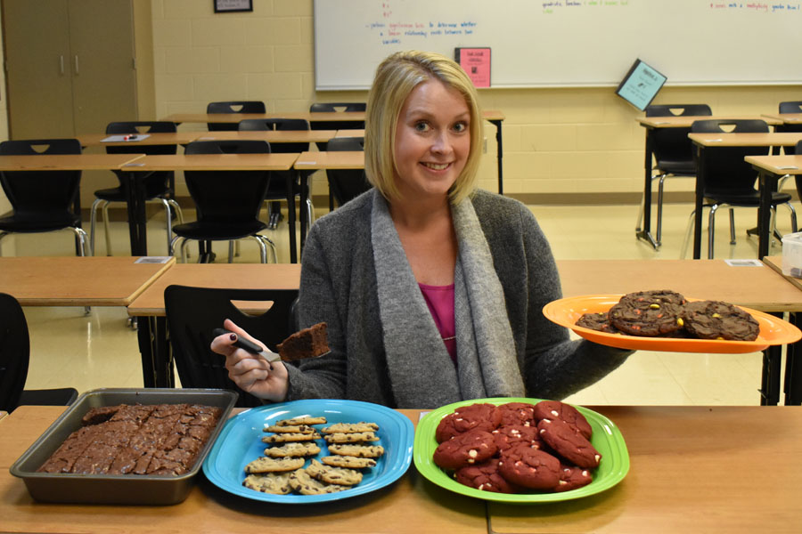 Mrs. Doyle poses with her scrumptious treats.