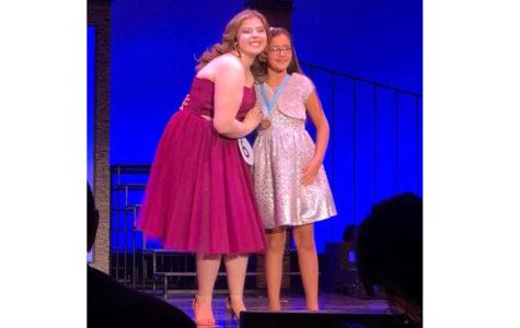 Caroline Handshoe on stage with her