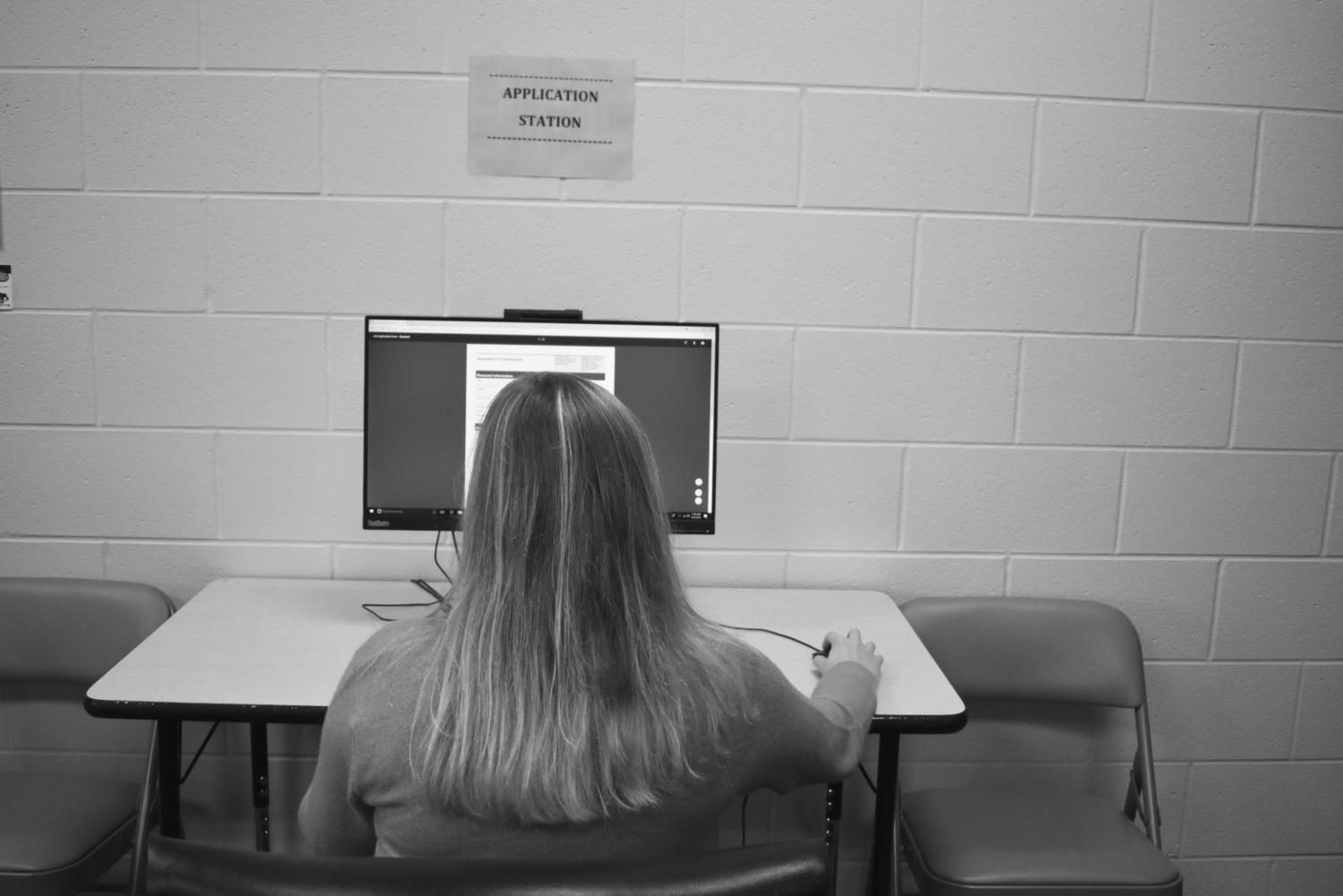 A student works at the Application Station in the Youth Service Center.