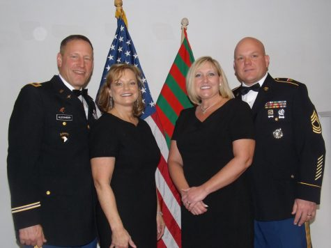 Colonel David Alexander, left, and his wife, pose with MSG Lee and his wife at the JROTC Military Ball