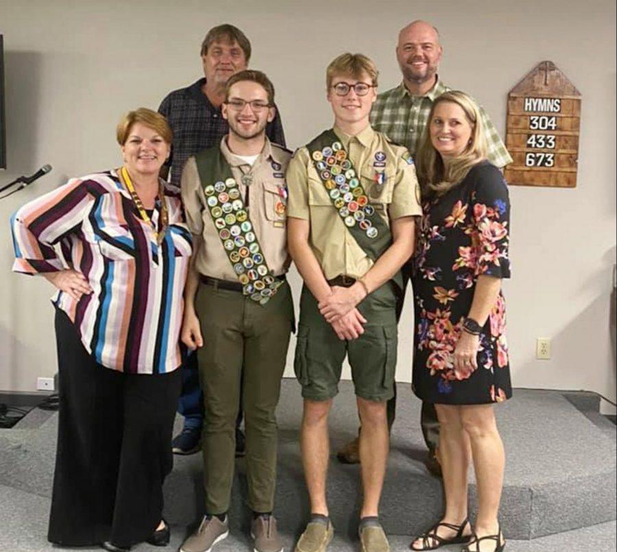 Ben Lambert, left, with his parents; and Garrett Boley with his parents