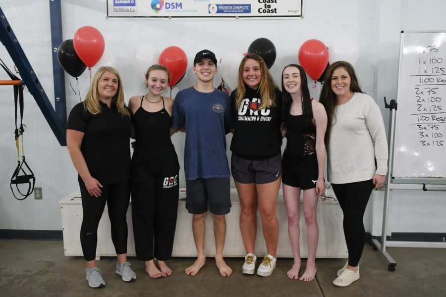 Swim coaches and seniors, from left, Coach Christi Jones, Ella Lucas, Brandon Rogers, EA Nisbet, Kelsey Grissam, and former coach Heather White