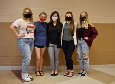 Cardinal Yearbook staff, from left, Lexi Garza, Ella Lucas, teacher Andi Rector, Haleigh Riddell and Delaney Peters