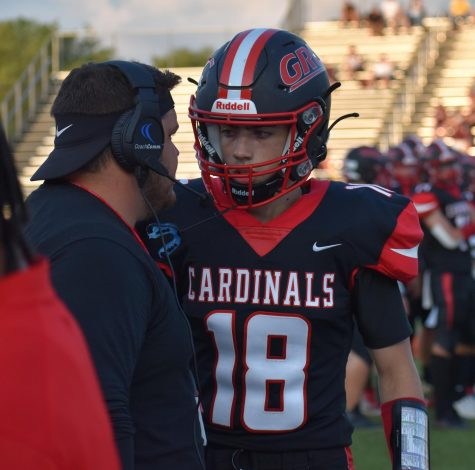 QB Brady Denham strategizes with Coach Ray at the Cards first home game.