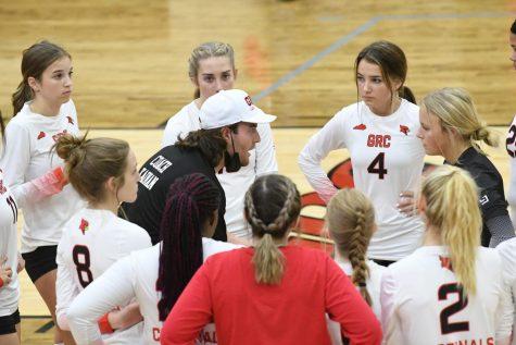 Volleyball Coach Kainan Hudson talks to his team.