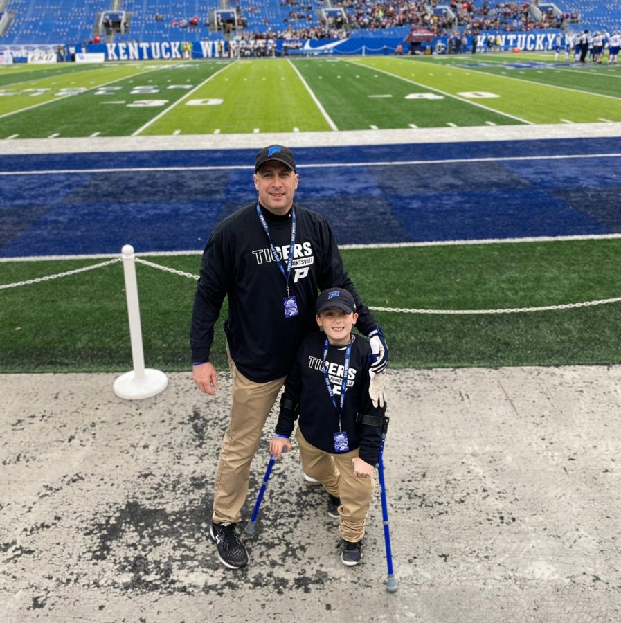 Coach Chirico and Brayden after winning the Class A state championship at Kroger Field.